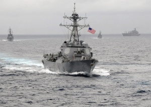 The US Navy guided-missile destroyer USS Lassen sails in the Pacific Ocean in a November 2009 photo provided by the U.S. Navy. The U.S. Navy sent a guided-missile destroyer within 12 nautical miles of artificial islands built by China in the South China Sea on October 27, 2015, a U.S. defense official said, in a challenge to China's territorial claims in the area. The official said the USS Lassen was sailing near Subi and Mischief reefs in the Spratly archipelago, features that were submerged at high tide before China began a massive dredging project to turn them into islands in 2014.  REUTERS/US Navy/CPO John Hageman/Handout via Reuters ATTENTION EDITORS - FOR EDITORIAL USE ONLY. NOT FOR SALE FOR MARKETING OR ADVERTISING CAMPAIGNS. THIS IMAGE HAS BEEN SUPPLIED BY A THIRD PARTY. IT IS DISTRIBUTED, EXACTLY AS RECEIVED BY REUTERS, AS A SERVICE TO CLIENTS      TPX IMAGES OF THE DAY